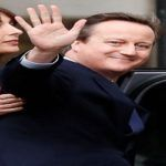 Britain's outgoing Prime Minister, David Cameron,waves in front of number 10 Downing Street, in central London