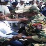 MUMBAI, MAR 10 (UNI)-Police detaining Congress members during their protest against Maharashtra Education and Cultural Affairs Minister, Vinod Tawde in Mumbai on Thursday. UNI PHOTO-111U
