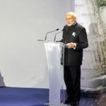 (L-R) Prime Minister Narendra Modi addressing at the Innovation Summit in COP 21, in Paris on November 30, 2015. At the COP 21, India had talked about the ratification the Paris Climate Agreement. Photo: PIB; A man carries schoolchildren through a flooded street during monsoon rains in Mumbai. Photo: UNI