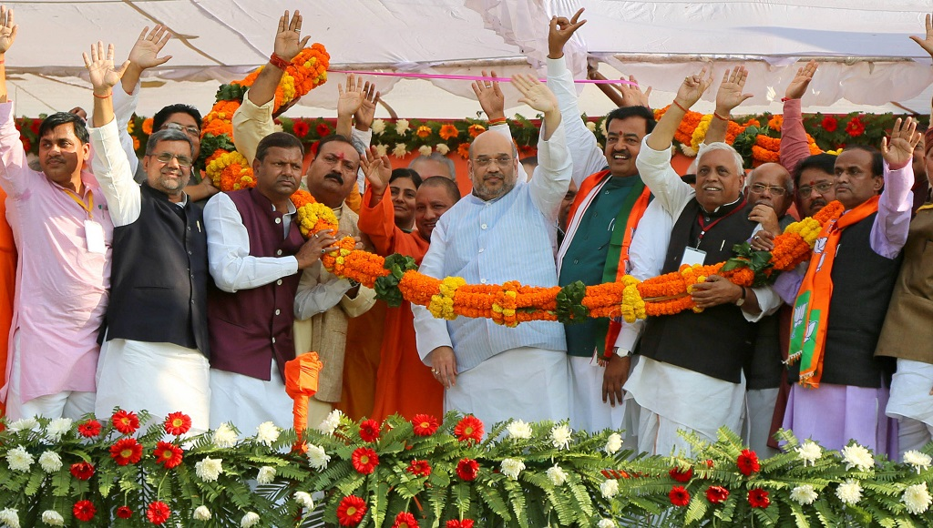 BJP national president Amit Shah and others in Maharajganj. Photo: UNI