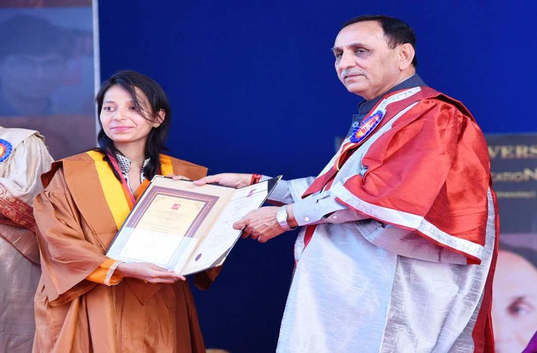 Gujarat Chief Minister Vijay Rupani honouring a student at a convocation ceremony in Ahmedabad. Photo: UNI