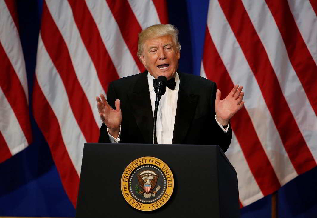"""Let's make America great again- U.S. President Donald Trump speaks at the """"Salute to Our Armed Forces"""" inaugural ball during inauguration festivities in Washington, U.S. January 20, 2017. REUTERS-13R"""