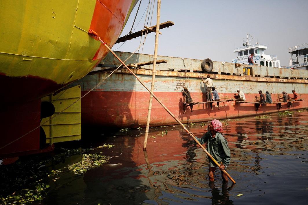 MEN AT WORK: Bangladeshi workers repair ferries in a dockyard in Dhaka, Bangladesh, January 14, Reuters/UNI