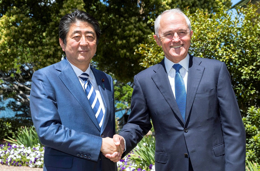 WARMING TIES: Japanese Prime Minister Shinzo Abe and Australian Prime Minister Malcolm Turnbull shake hands before their bilateral meeting at Kirribilli House in Sydney, Australia, January 14, Reuters/UNI
