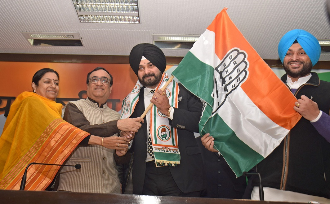 NEXT CHANGE: Former cricketer Navjot Singh Sidhu who joined the Congress party is presented a party flag during a press conference in New Delhi on January 16, UNI