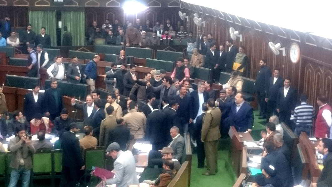 NOISE HOUR: Opposition members of National Conference and Congress parties jointly stage protests at the Jammu & Kashmir Assembly Well during question hour before walking out over lack of development in Jammu region for the last two years, UNI