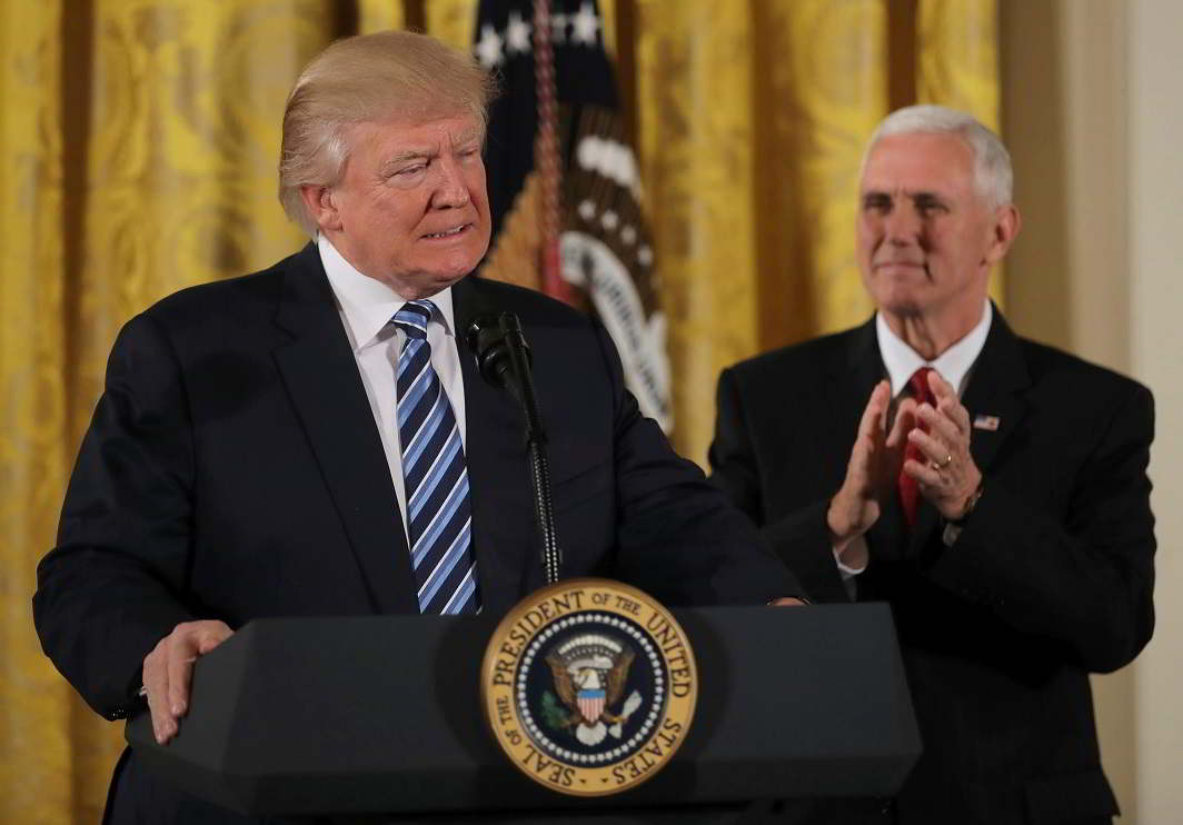 WHO'S THE BOSS? US President Donald Trump attends a swearing-in ceremony for senior staff with Vice-President Mike Pence at the White House in Washington, DC, January 22, Reuters/UNI