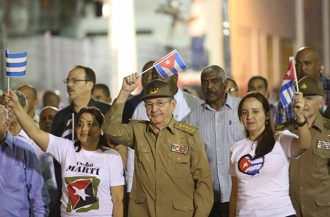 CASTRO'S HERO: President Raul Castro (C) takes part in a march to celebrate the 164th birth anniversary of Cuba's independence hero Jose Marti in Havana, Reuters/UNI