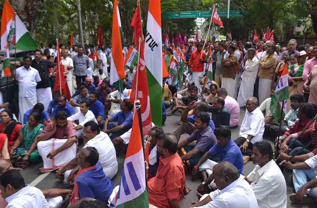 FLAGGING GRIEVANCES: Various trade union activists sit on dharna outside the Kerala Raj Bhavan in Thiruvananthapuram, UNI