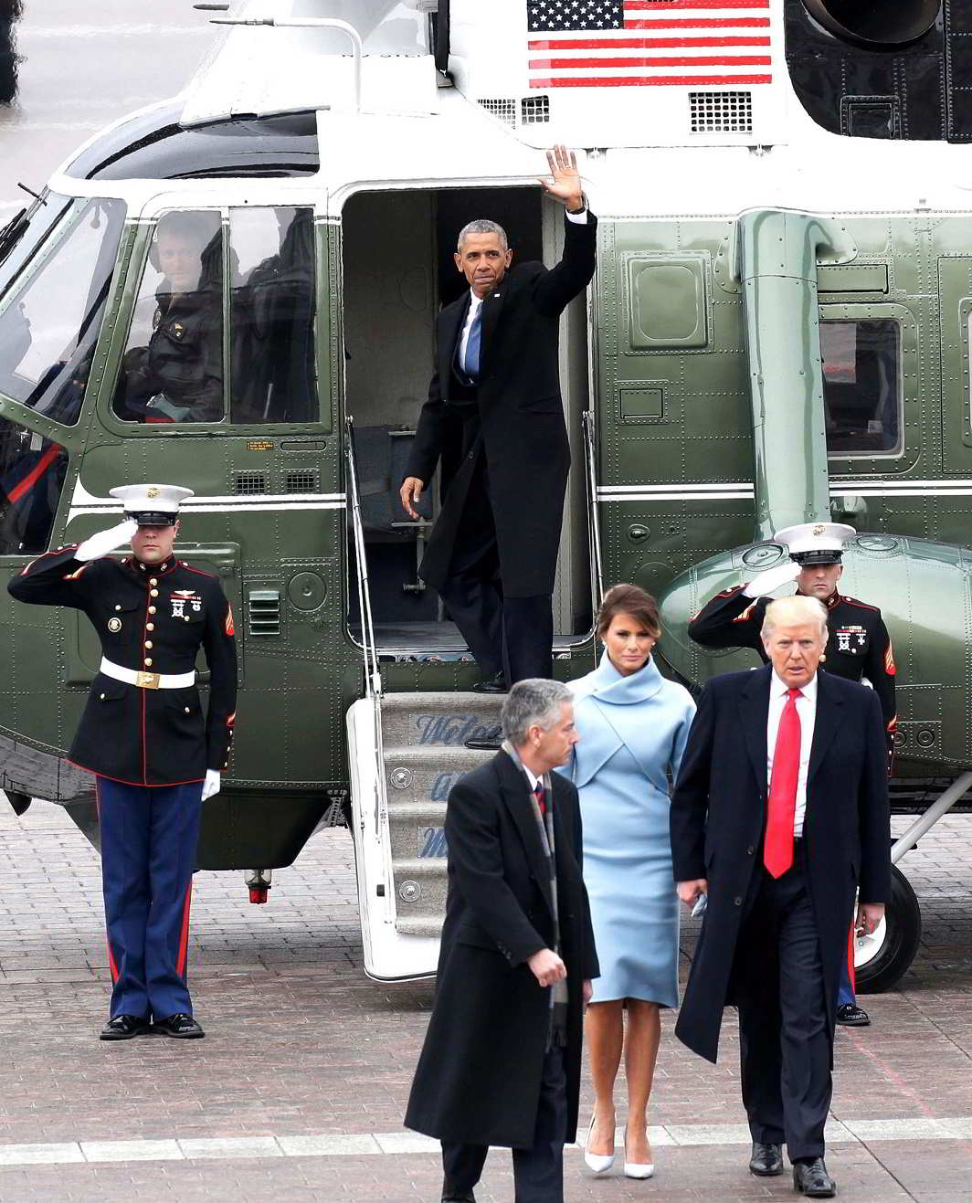 The Final Goodbye- Former President of the United States Barack Obama waves from a Marine One helicopter as newly elected United States President Donald Trump walks with wife Melania Trump back to the Capitol Building after Trump is sworn in at the 58th Presidential Inauguration on Capitol Hill in Washington, D.C., U.S., January 20, 2017. REUTERS-9R