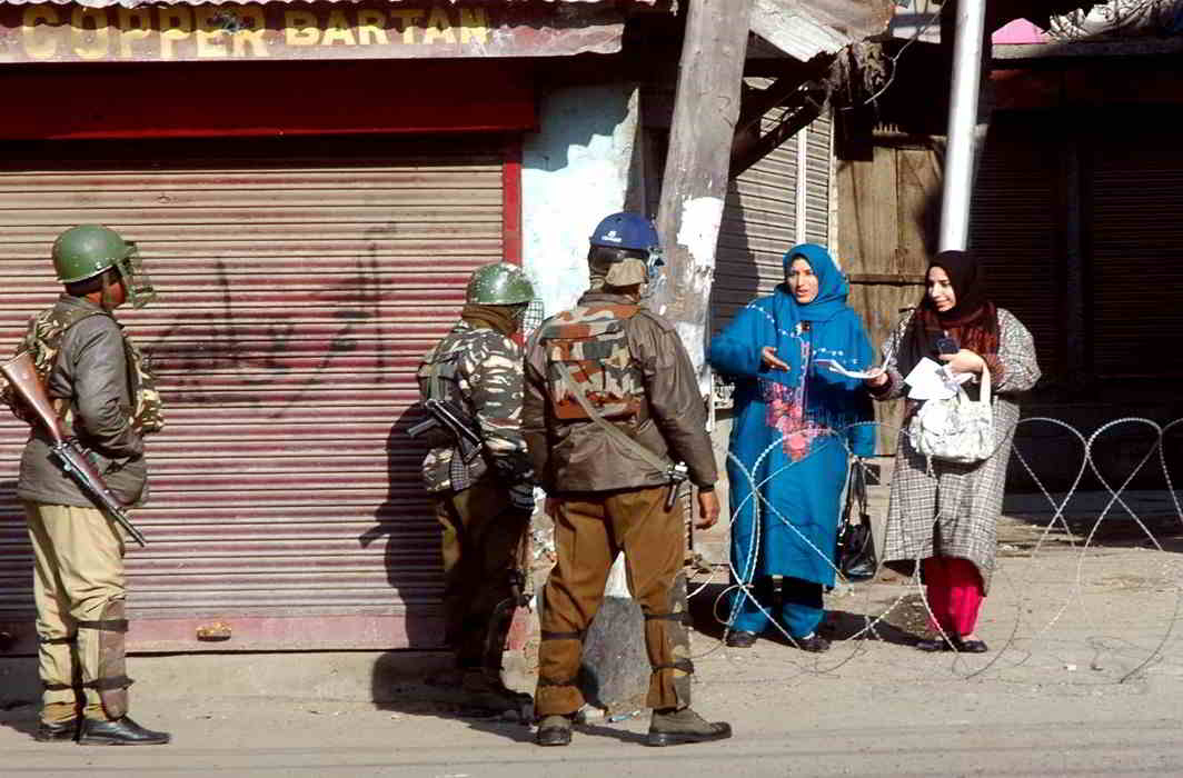NO GO: Women ask security-persons to let them go to work at Nawakadal Road, closed following separatists' call to march to United Nations Military Observers Group for India and Pakistan at Sonwar from Lal Chowk in Srinagar on February 10, UNI