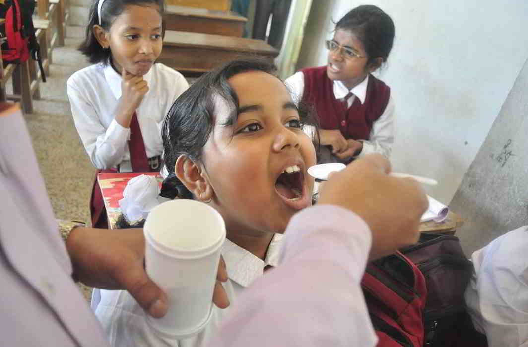 KEEP HEALTHY: Health department officials administer deworming medicine to schoolchildren on National Deworming Day, at a school in Agartala on February 10, UNI