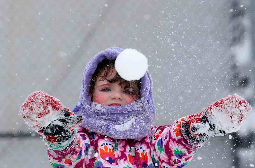 LAST SNOW OF WINTERS: A girl plays in the snow in Brooklyn, New York City, on February 9, Reuters/UNI