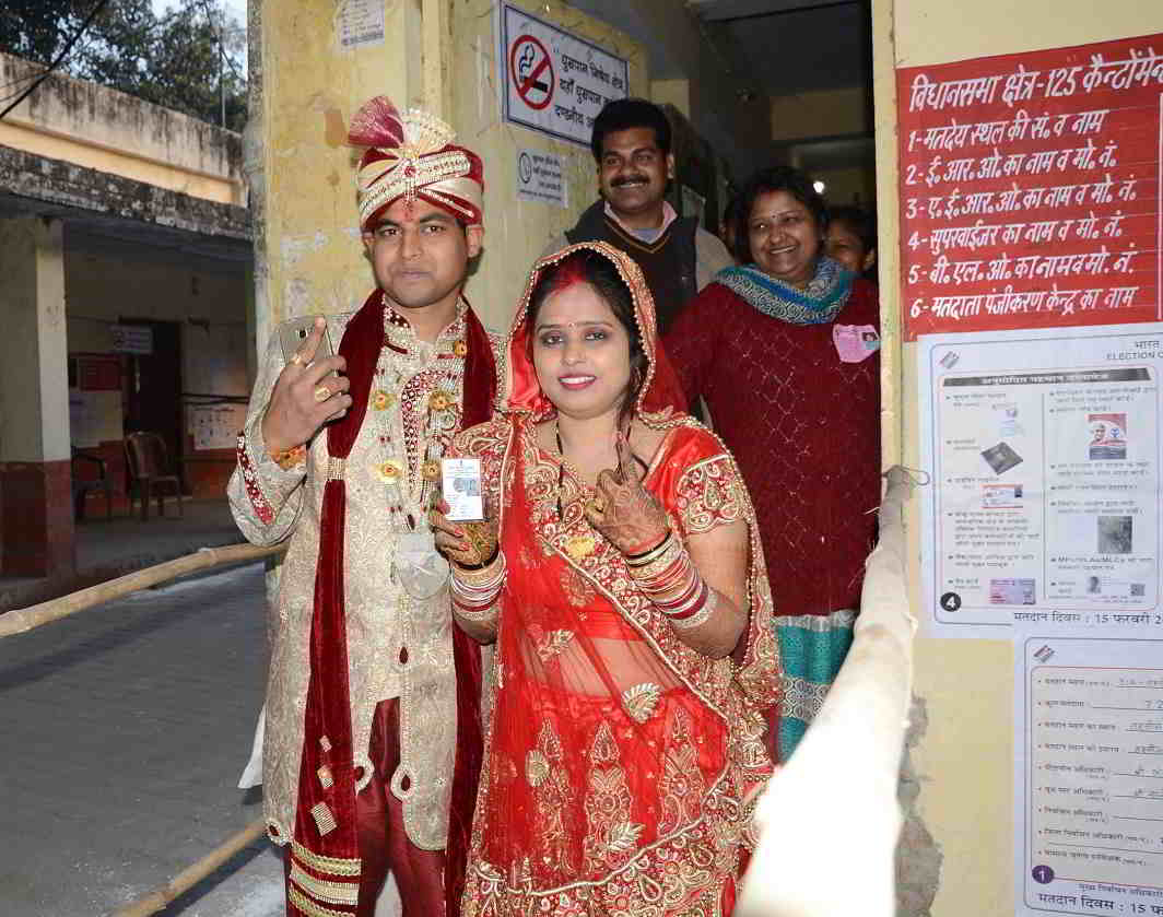 FOR A BETTER FUTURE: A newly-wedded couple comes out of a polling booth after casting their votes during the second phase of the Uttar Pradesh assembly polls in Bareilly, UP, UNI