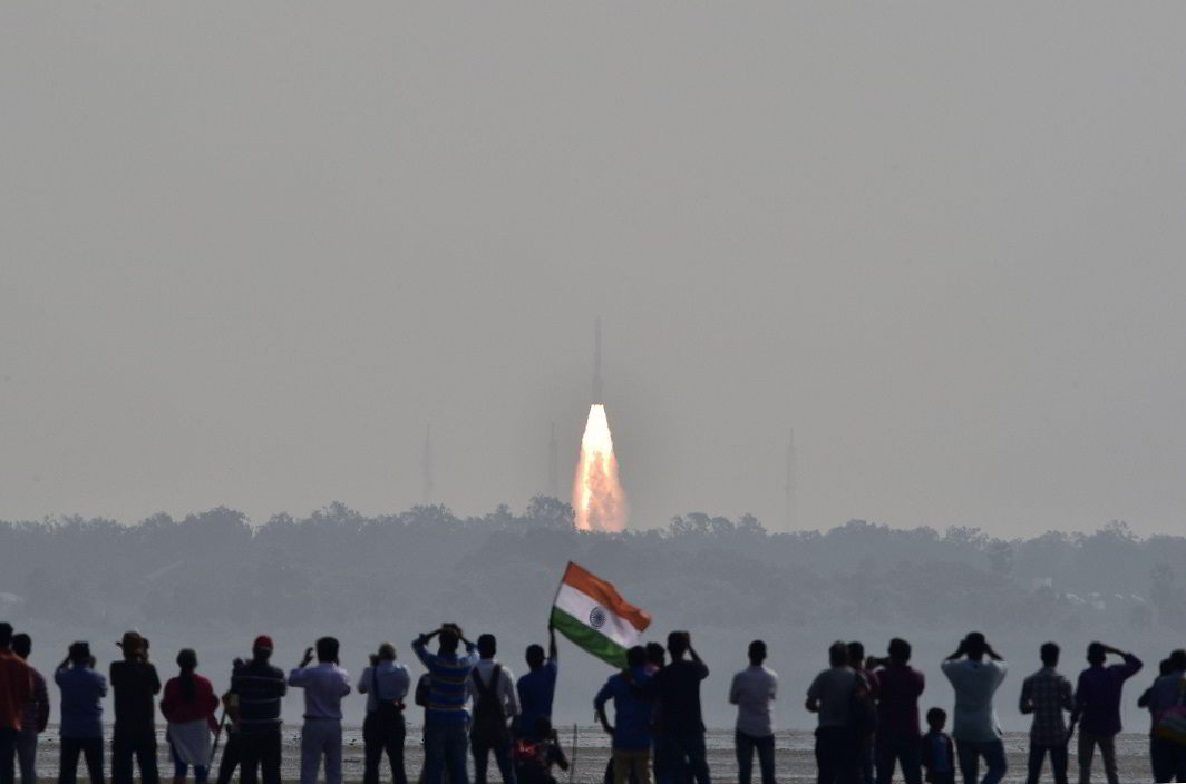 NATION'S PRIDE: People watch as India's Polar Satellite Launch Vehicle (PSLV-C37) carrying 104 satellites in a single mission lifts off from the Satish Dhawan Space Centre in Sriharikota, India, Reuters/UNI