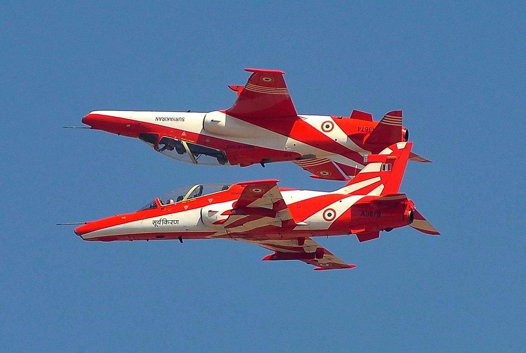 FLYING TWINS: The Indian Air Force's aerobatic display team 'Surya Kiran' performs during Aero India show at the Yelahanka Air Force Station in Bengaluru, Reuters/UNI