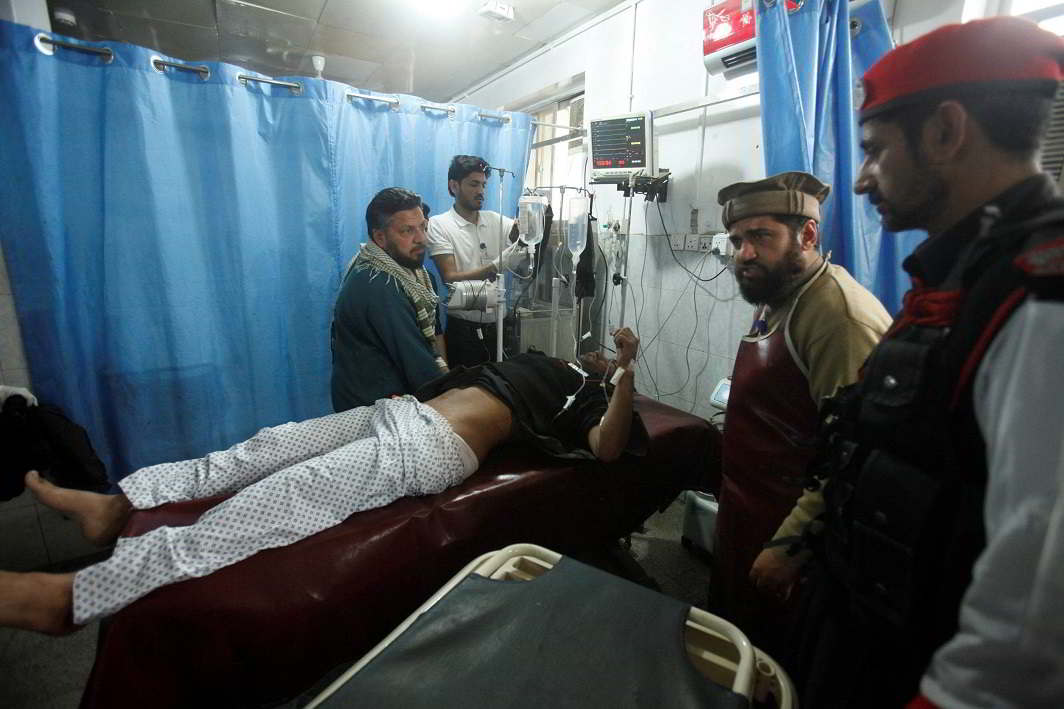 BADLY HURT: A man injured during a suicide attack in Mohmand Agency receives treatment after being brought to Lady Reading Hospital in Peshawar, Pakistan, Reuters/UNI