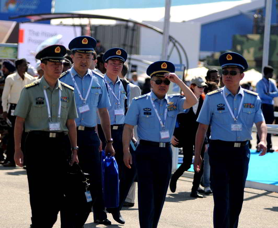 GAUGING THE ENEMY: A team of Chinese Airforce officers visit Aero India 2017 on the 2nd day, at Yelahanka airbase in Bengaluru, UNI