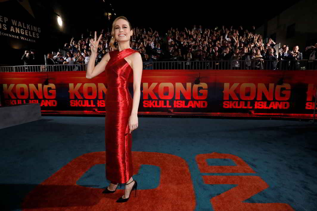 """WOMAN IN RED: Cast member Brie Larson poses at the premiere of """"Kong: Skull Island"""" in Los Angeles, Reuters/UNI"""