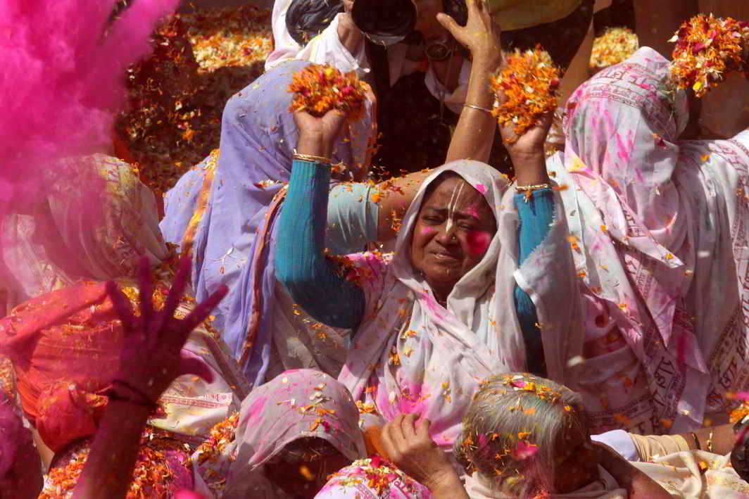 BREAK WITH CONVENTION: Widows of Vrindavan play with colours during Holi Mahotsav organised by Sulabh International at Gopinath temple in Vrindavan, UNI