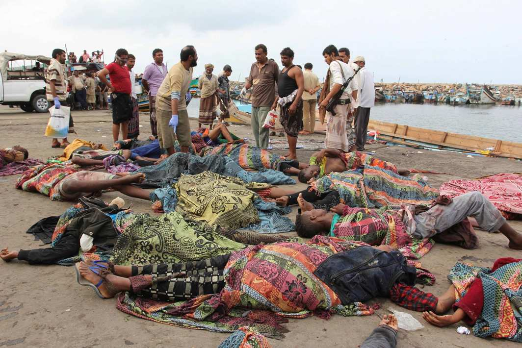 END OF DAYS: Yemeni police officers check the bodies of Somali refugees, killed in attack by a helicopter while travelling in a vessel off Yemen, at the Red Sea port of Hodeidah, Yemen, Reuters/UNI