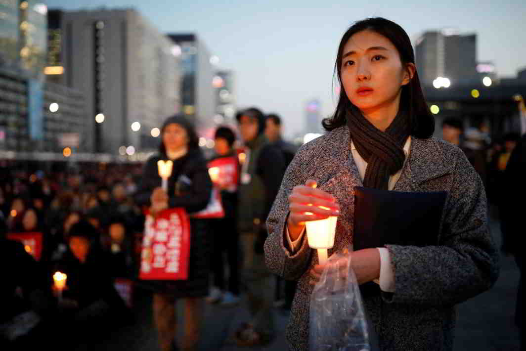 ANGER AND ANGST: People attend a rally calling for impeached President Park Geun-hye's arrest in central Seoul, South Korea, Reuters/UNI