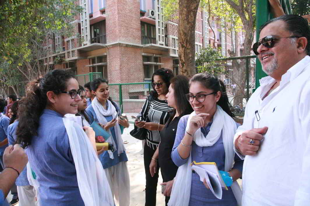 EASY DOES IT: Students at the examination centre before appearing in CBSE Class 12 exam in New Delhi, UNI