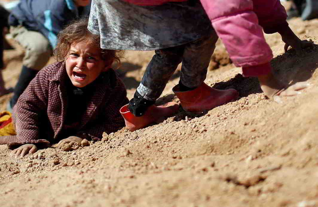 COLLATERAL DAMAGE: A displaced Iraqi girl cries before entering Hamam al-Alil camp, as Iraqi forces battle with Islamic State militants, in western Mosul, Reuters/UNI