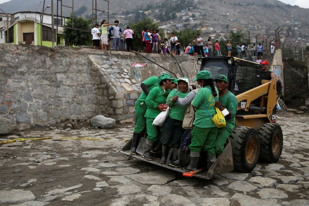 WHEN DISASTER STRIKES: A loader carries a group of workers from the municipality of Chosica after a landslide and flood in Chosica, east of Lima, Peru, Reuters/UNI