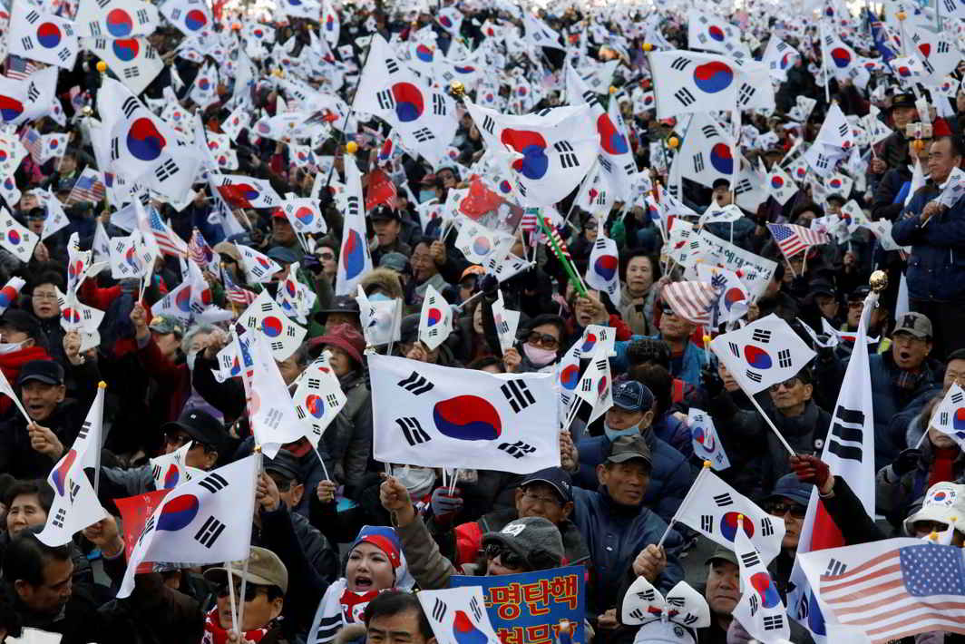 MANY IN HIS CORNER: Supporters of South Korean President Park Geun-hye wave the national flag, Taegeukgi, during a protest near the Constitutional Court, a day before South Korea's Constitutional Court ruling on his impeachment, in Seoul, Reuters/UNI
