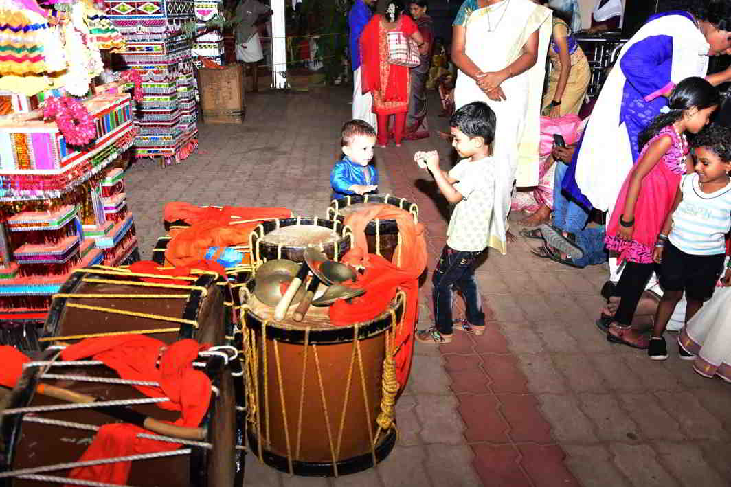 LEARNING IS FUN: Children try their hands on drums at the famed Attukal temple at Thiruvananthapuram, UNI