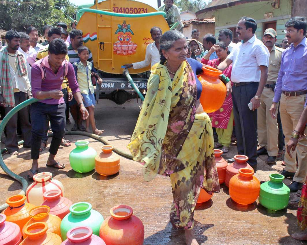 PICTURE OF SCARCITY: Drinking water is being supplied through tankers at a village as residents facing water shortage, in Belagavi, UNI