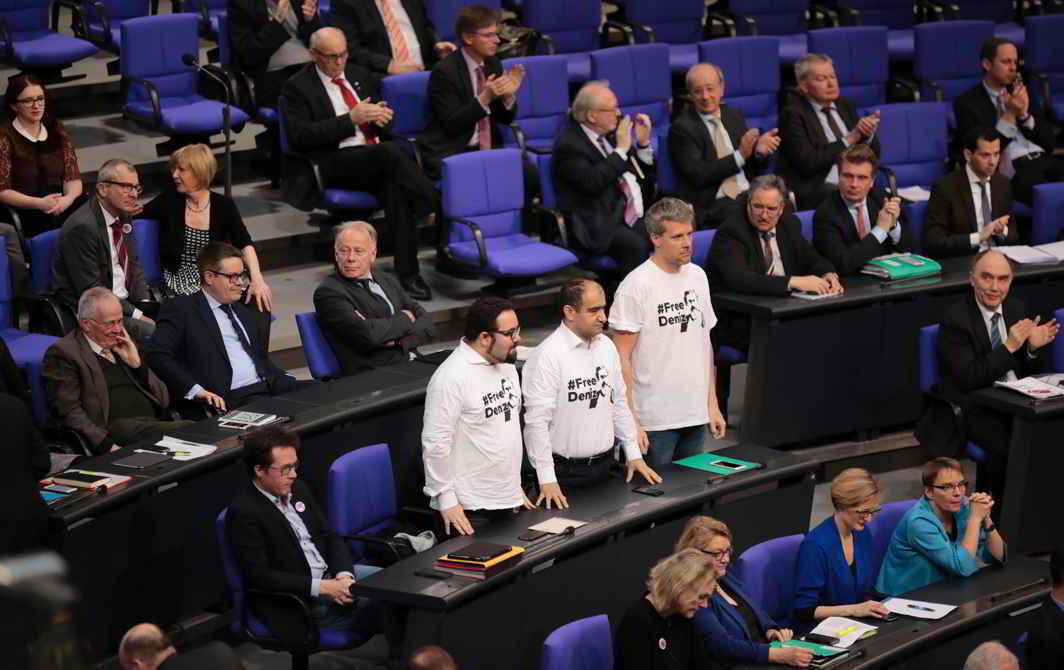 """GAG ON FREE SPEECH: Members of the German lower house of parliament Bundestag wear t-shirts with the slogan """"#Free Deniz"""" during a session in Berlin. The arrest of journalist Deniz Yücel is the latest in a broad crackdown on the media in Turkey after July's failed coup, Reuters/UNI"""