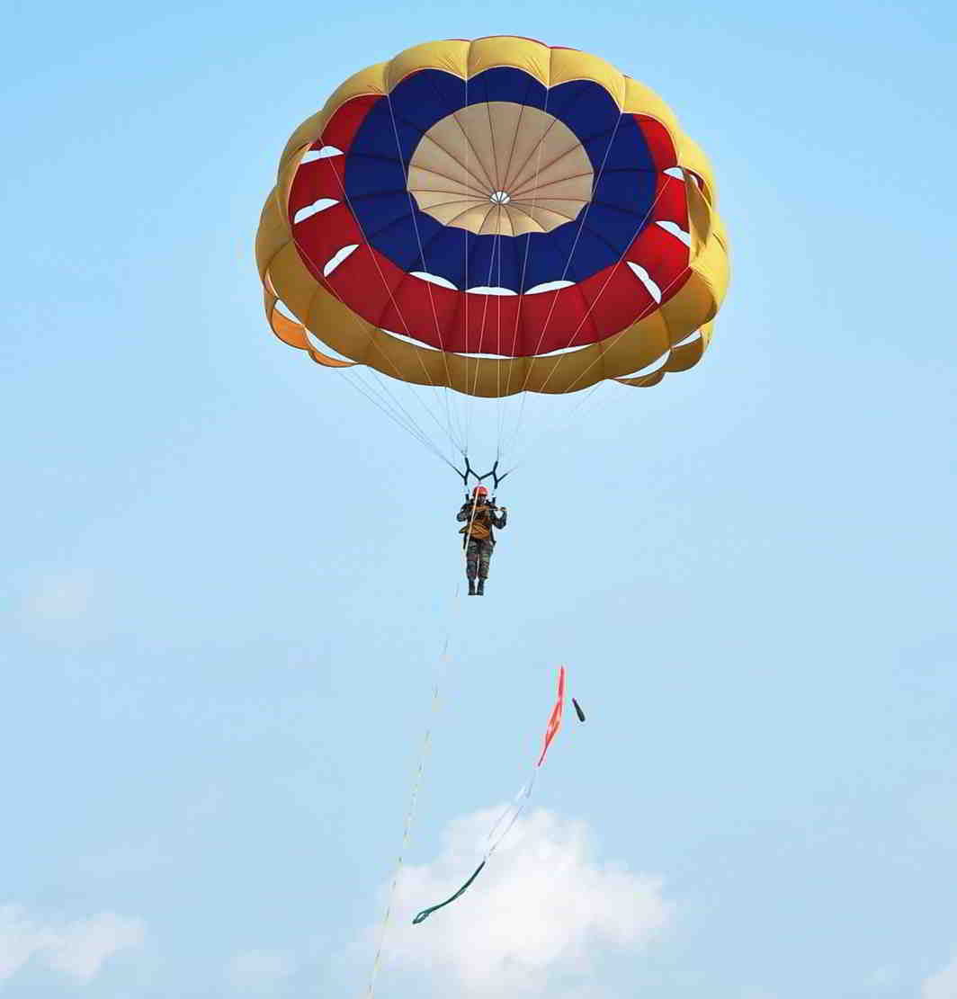 FLY AWAY: Cadet Rashmita parasailing during the Combined Display at Officer Training Academy (OTA), in Chennai, UNI
