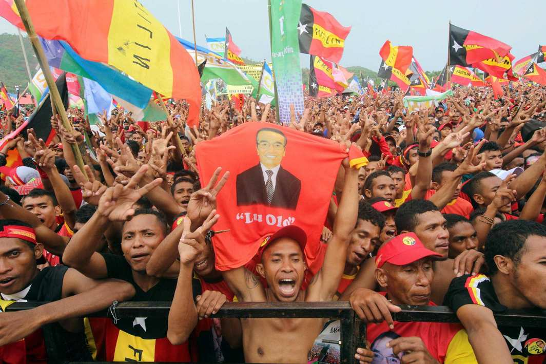 GO GUTERRES: Supporters of presidential candidate Francisco Guterres of the Revolutionary Front for an Independent East Timor (FRETILIN) party cheer at a campaign rally ahead of next week's elections, in Tasi Tolu, Dili, East Timor, Reuters/UNI