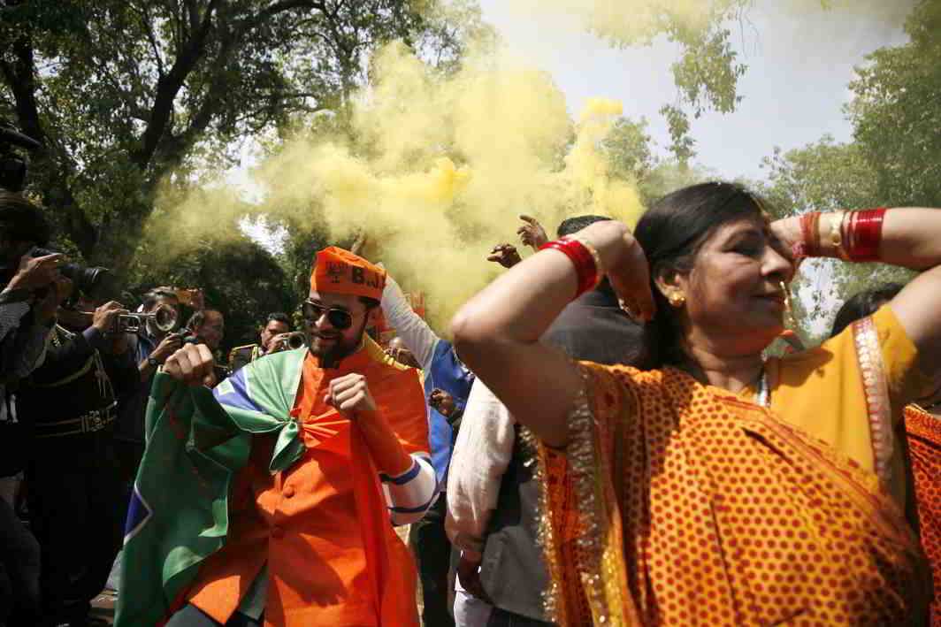 WINNER TAKE ALL: Scenes of jubilation at the BJP headquarters in New Delhi on Saturday