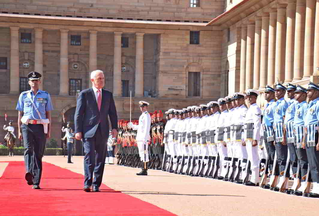 NEW GUEST IN TOWN: Prime Minister of Australia Malcolm Turnbull inspects a guard of honour during a reception at Rashtrapati Bhavan in New Delhi, UNI