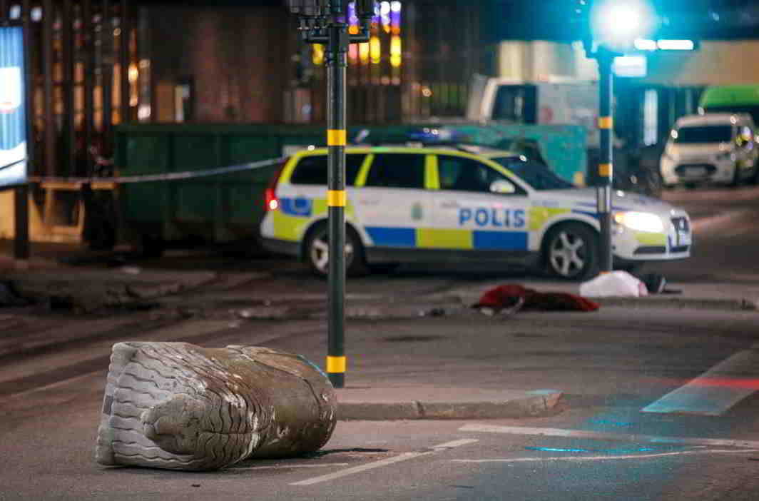TRAGEDY STRIKES: A turned over, 'Stockholmslejon', a concrete traffic stopper, is seen outside the roped off area near the department store Ahlens after a suspected terror attack on Drottninggatan Street in central Stockholm, Sweden. Four people were killed and 15 were injured when a lorry crashed into the front of a department store. A man has been arrested, Reuters/UNI