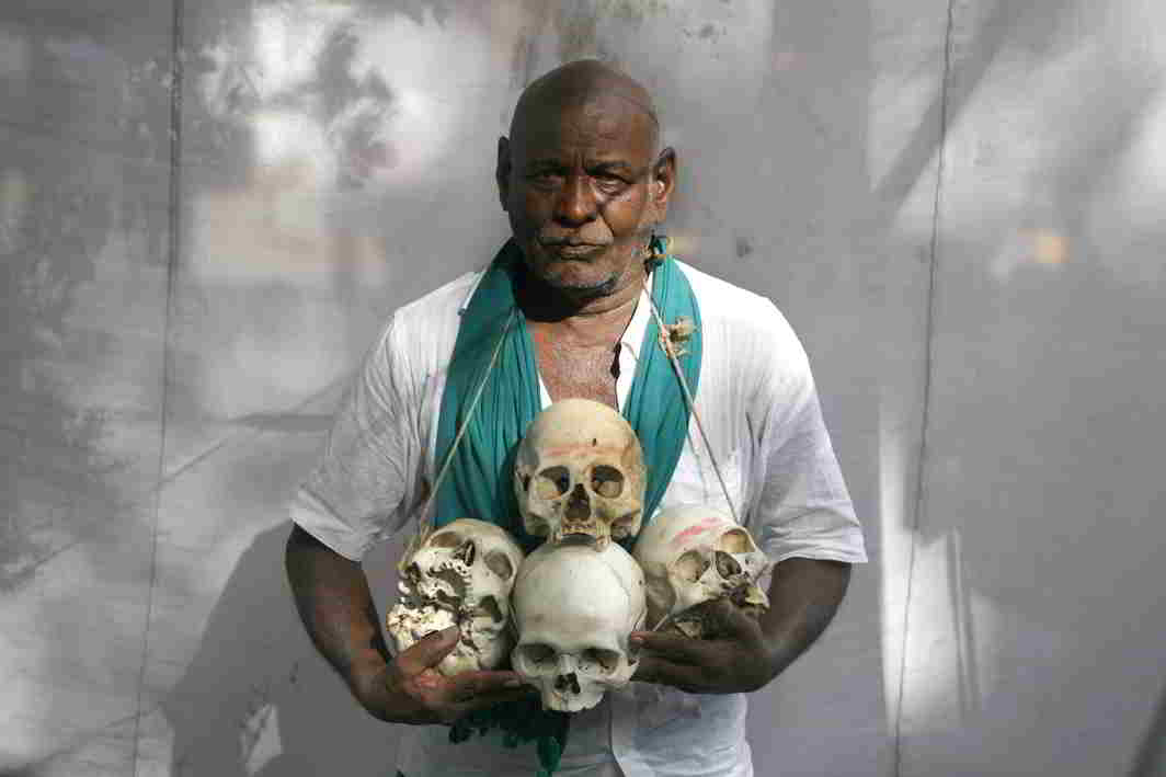 THE SURVIVOR: A protester displays the skulls of his brethren who committed suicide