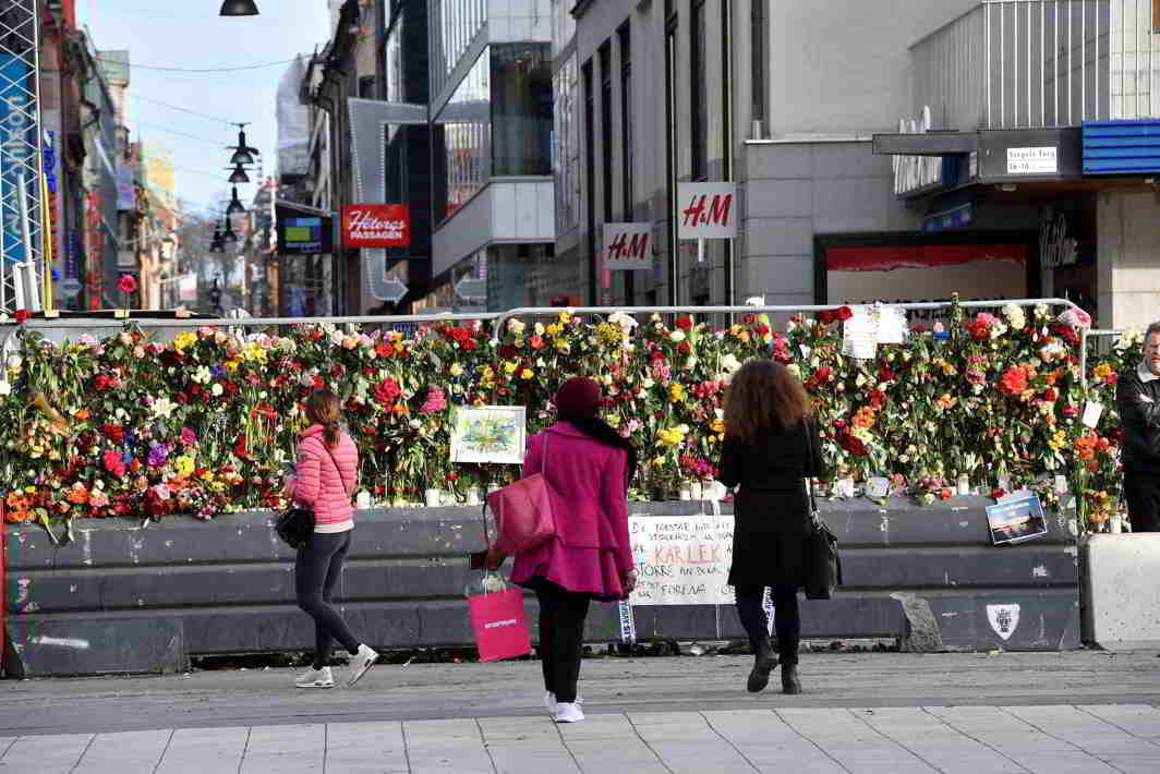 HOPE, PRAY, REMEMBER: Flowers are seen on a fence by Ahlens department store following April 7's attack in central Stockholm, Sweden, Reuters/UNI