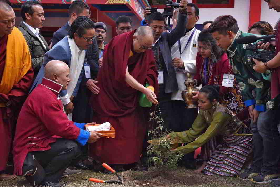 NURTURE NATURE: The Dalai Lama waters a plant during his visit to Jangchub Chorten in Tawang in the northeastern state of Arunachal Pradesh, Reuters/UNI