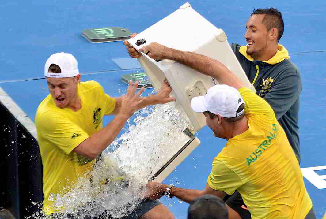THROUGH TO SEMIS: Australia's Nick Kyrgios pours ice over team captain Lleyton Hewitt after Australia defeated the USA in their Davis Cup quarterfinal matches during Australia v/s USA, Pat Rafter Arena, Brisbane, Australia, Reuters/UNI