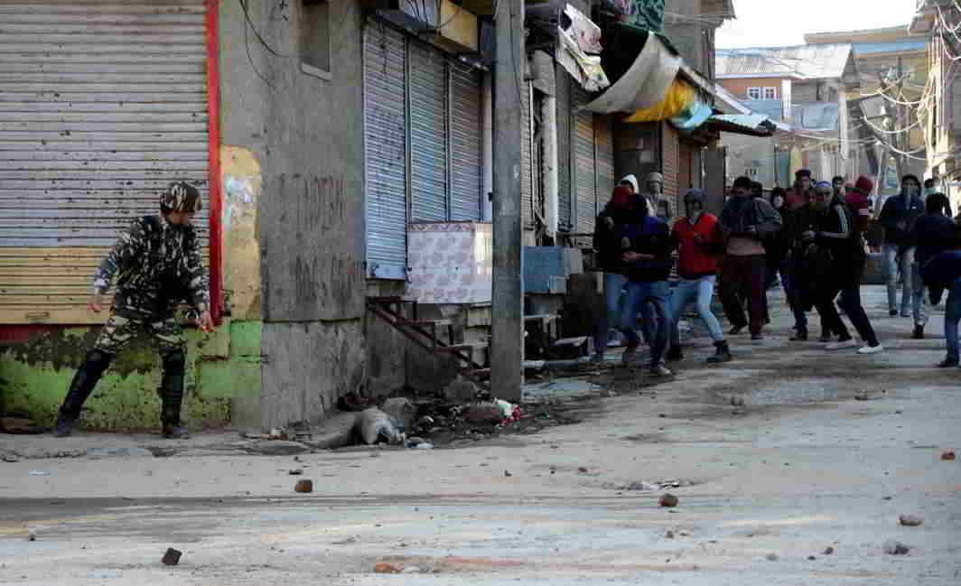 Security forces and stone pelters fight a pitched battle during intense clashes that erupted at Soura in Srinagar in February, UNI