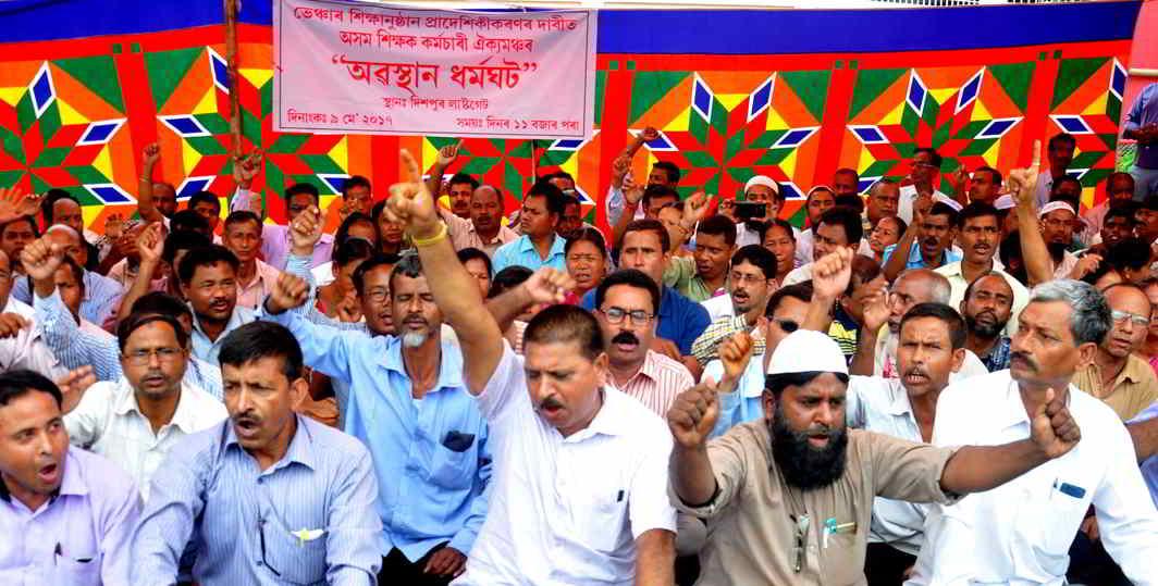 TEACHERS, UNITE: Members of Asom Teacher Karmachari Aikya Mancha stage a dharna in Guwahati, UNI