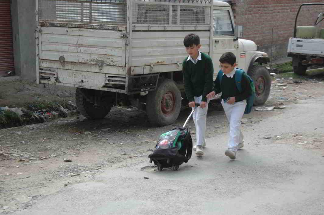 BURDEN OF PERFORMANCE: Children walk home from school at Udranna Bhaderwah in Jammu & Kashmir, UNI