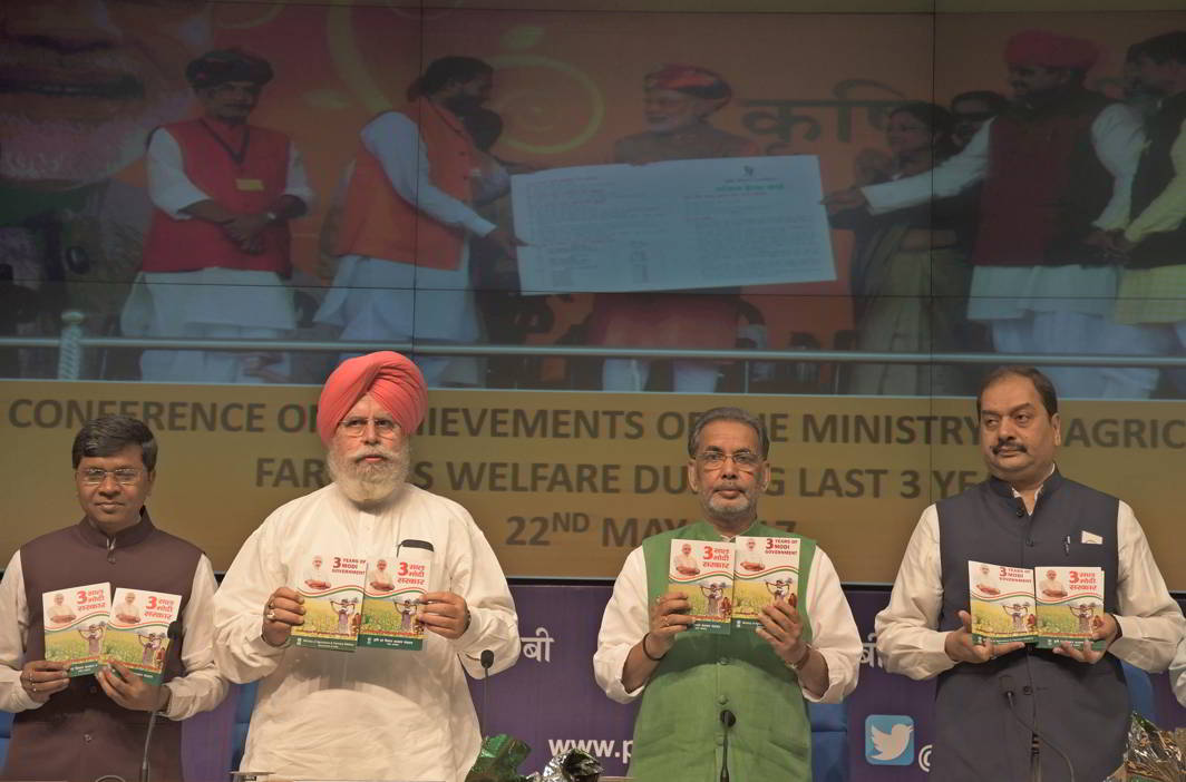 THREE YEARS OF ACCHE DIN: Union minister for agriculture and farmers welfare Radha Mohan Singh with minister of state for agriculture & farmers welfare and parliamentary affairs SS Ahluwalia and minister of state for agriculture and farmers welfare Sudarshan Bhagat release a booklet at a press conference on the achievements of the ministry during three years of NDA rule in New Delhi, UNI