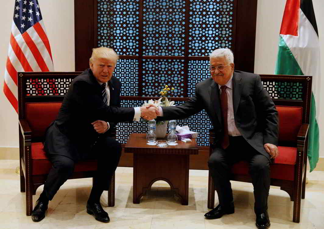 ACROSS THE DIVIDE: US President Donald Trump shakes hands with Palestinian President Mahmoud Abbas during their meeting at the presidential headquarters in the West Bank town of Bethlehem, Reuters/UNI
