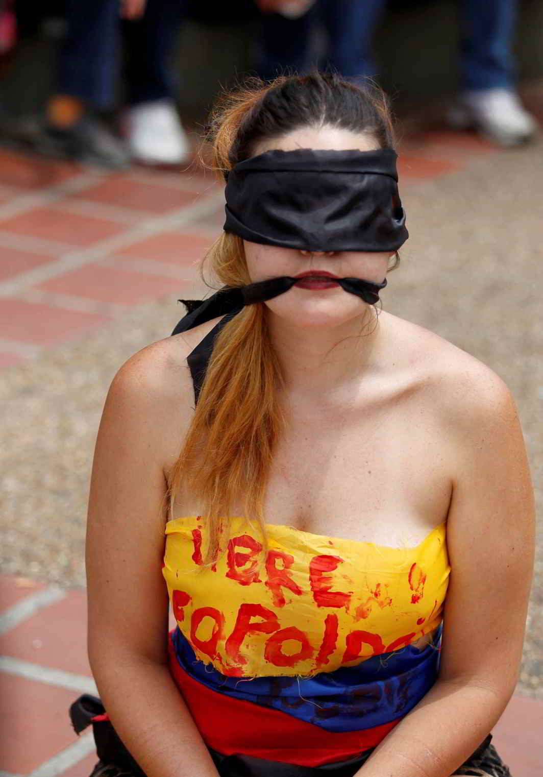 INJUSTICE IS BLIND, TOO: An opposition supporter participates in a rally against President Nicolas Maduro in Caracas, Venezuela, Reuters/UNI