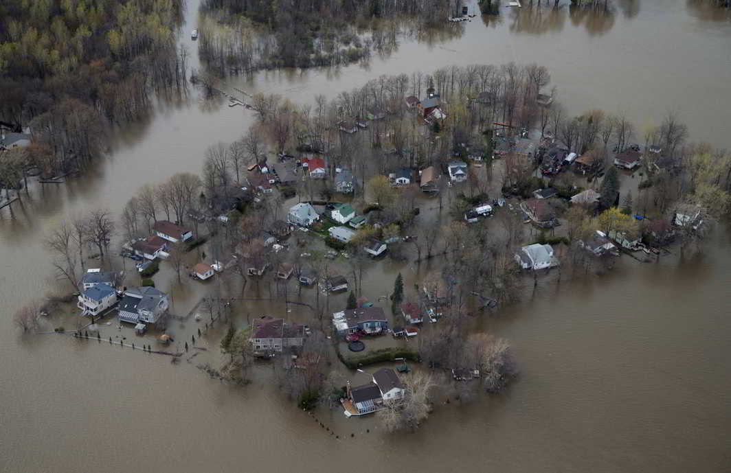 NATURE'S FURY: An overhead shot showing the flooded residential neighbourhood of Ile Mercier, Quebec, Reuters/UNI
