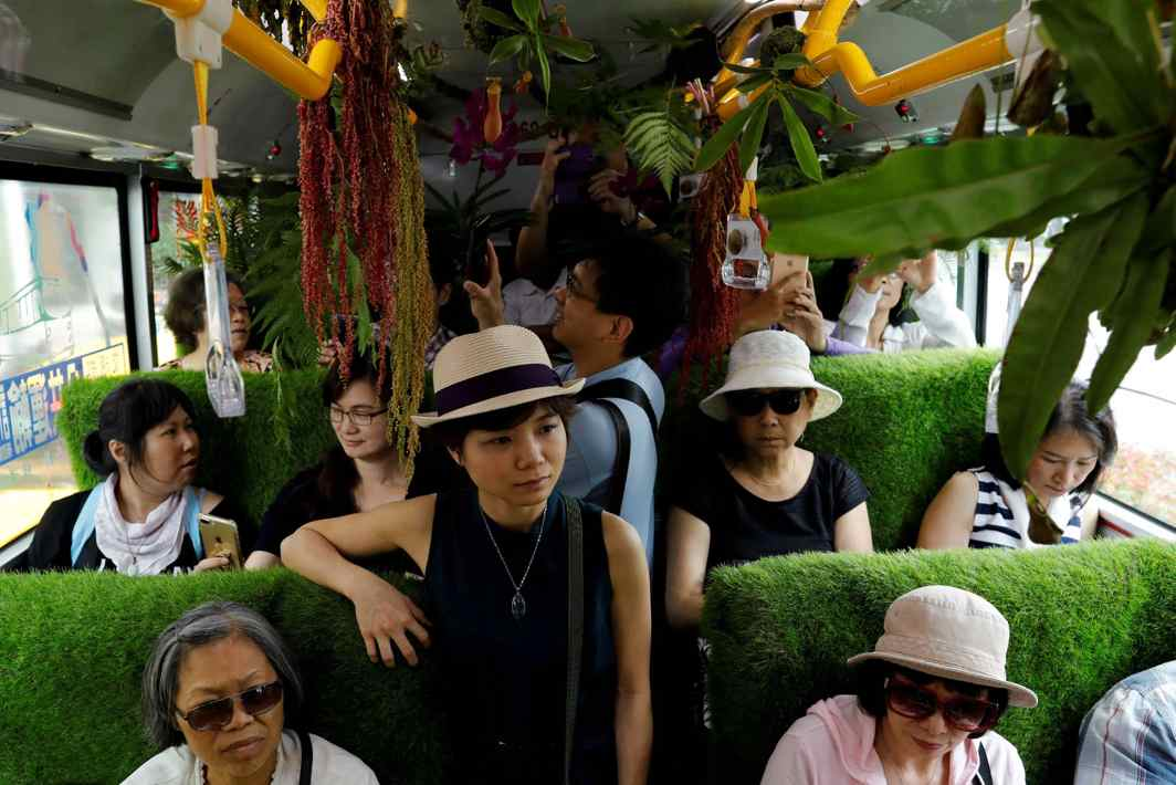 PLEASANT SURPRISE: Passengers inside a plant-filled bus, a special route that runs for five days, featuring the concept of integrating more green space into cities, in Taipei, Reuters/UNI